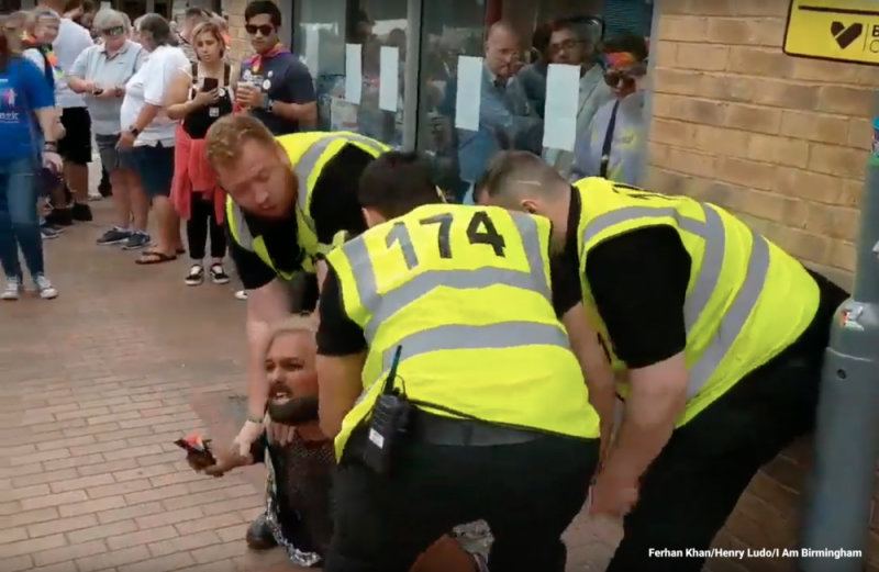 Ferhan Khan being forced to the ground by three members of the BirminghamPride security team