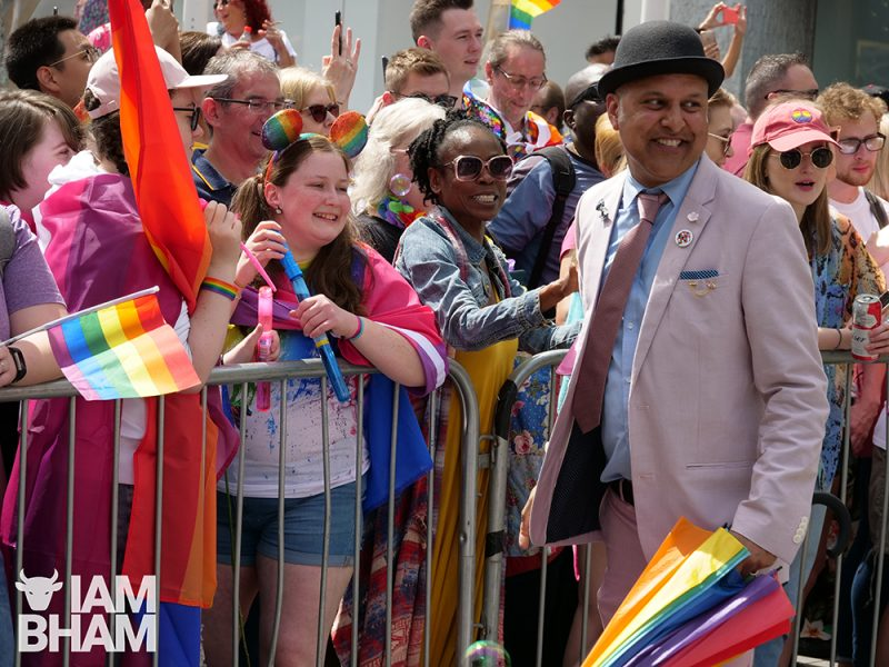 Khakan Qureshi meets friends during the Birmingham Pride 2019 parade