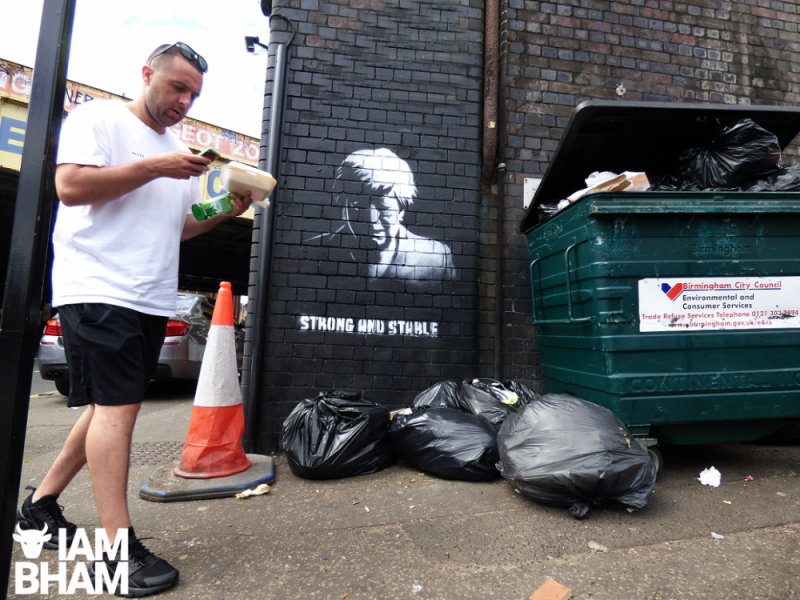 Members of the public have been photographing the street art of Theresa May crying
