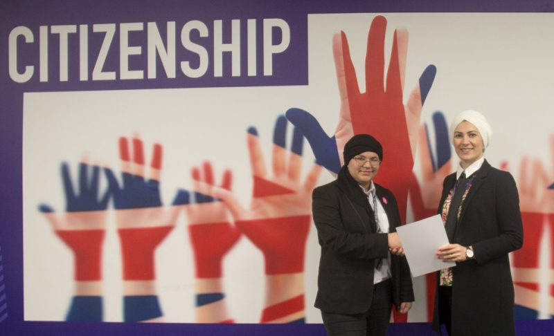Ramlah (left) being presented with a Star Letter and certificate by Principal Enass Al-Ani (right)