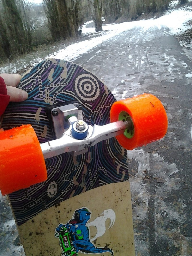 Longboarding in the snow with Don't Trip Poppies precision truck on a Long Board Larry Walkabout with Orangatang Kegel wheels in East Wenatchee Washington on 7 January 2015 by Thayne Tuason