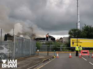 Safety warning issued as fire rages opposite City Hospital