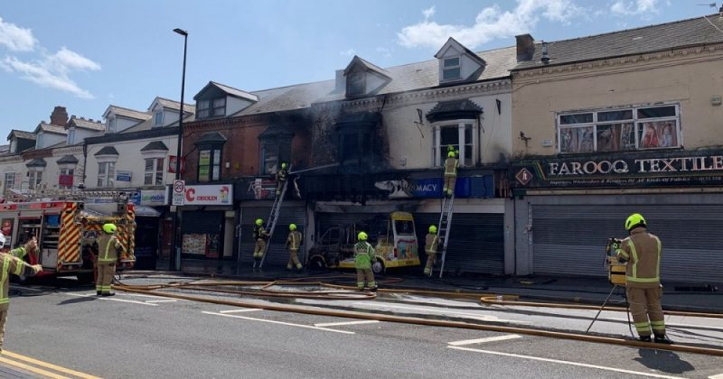 An ice cream van fire in Smethwick has spread to a nearby store
