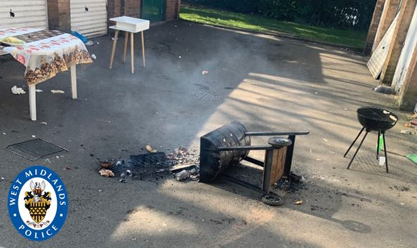 Police officers were forced to tip over the BBQ when the defiant group refused to leave