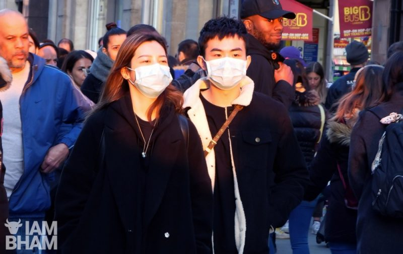 A couple wearing face masks in London's Oxford Street amid news of the coronavirus pandemic