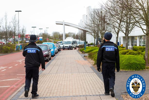 Police officers on patrol are remaining two meters apart to prevent the potential spread of coronavirus