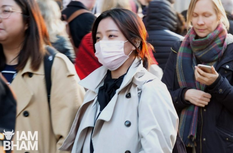 A woman wearing a face mask in London's Oxford Street amid news of the coronavirus pandemic