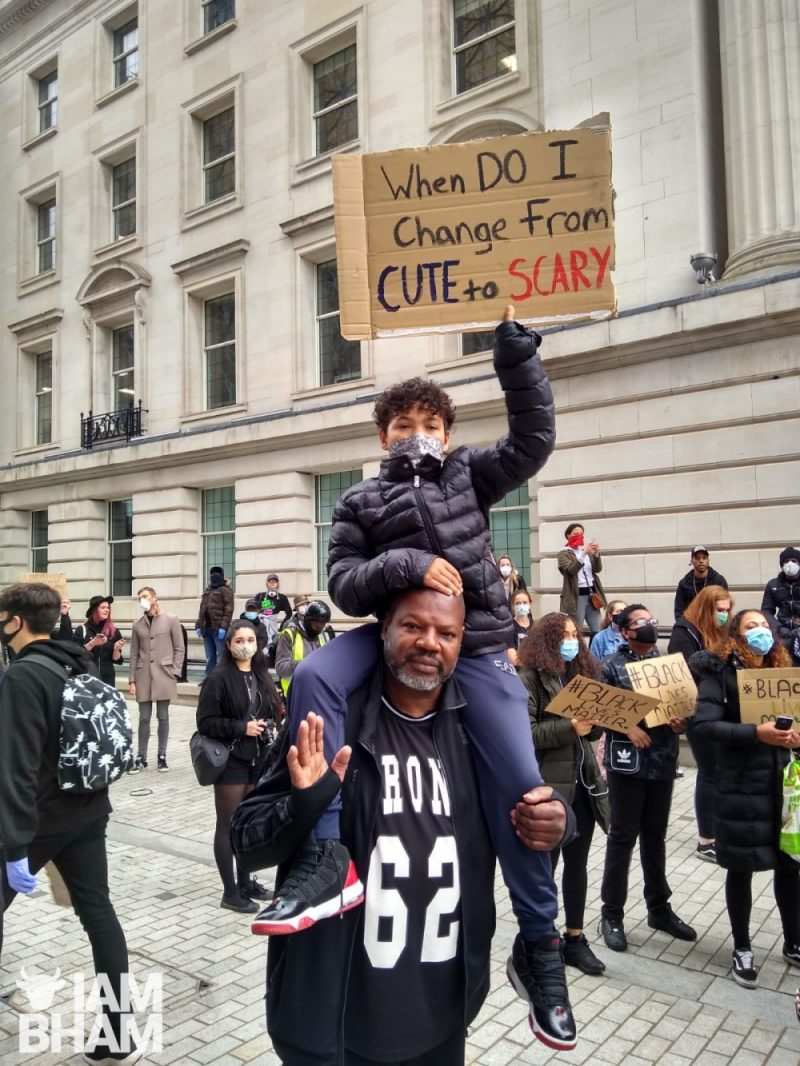 A father and son at the Birmingham 'Black Lives Matter' demonstration