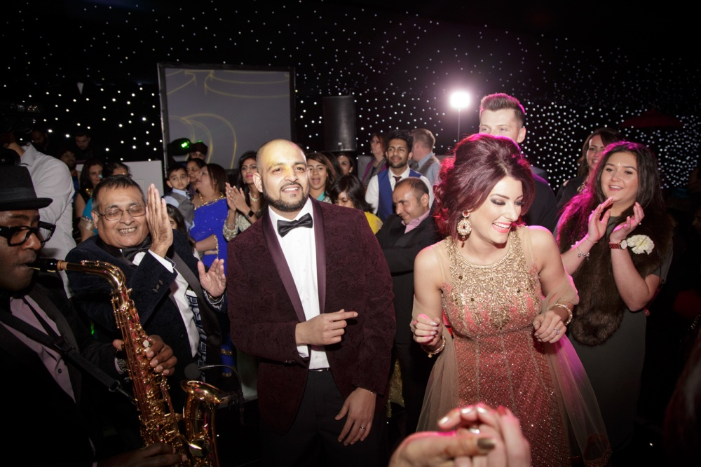 Close contact dancing and parties, shown here at a wedding before the coronavirus lockdown, are still banned at social gatherings