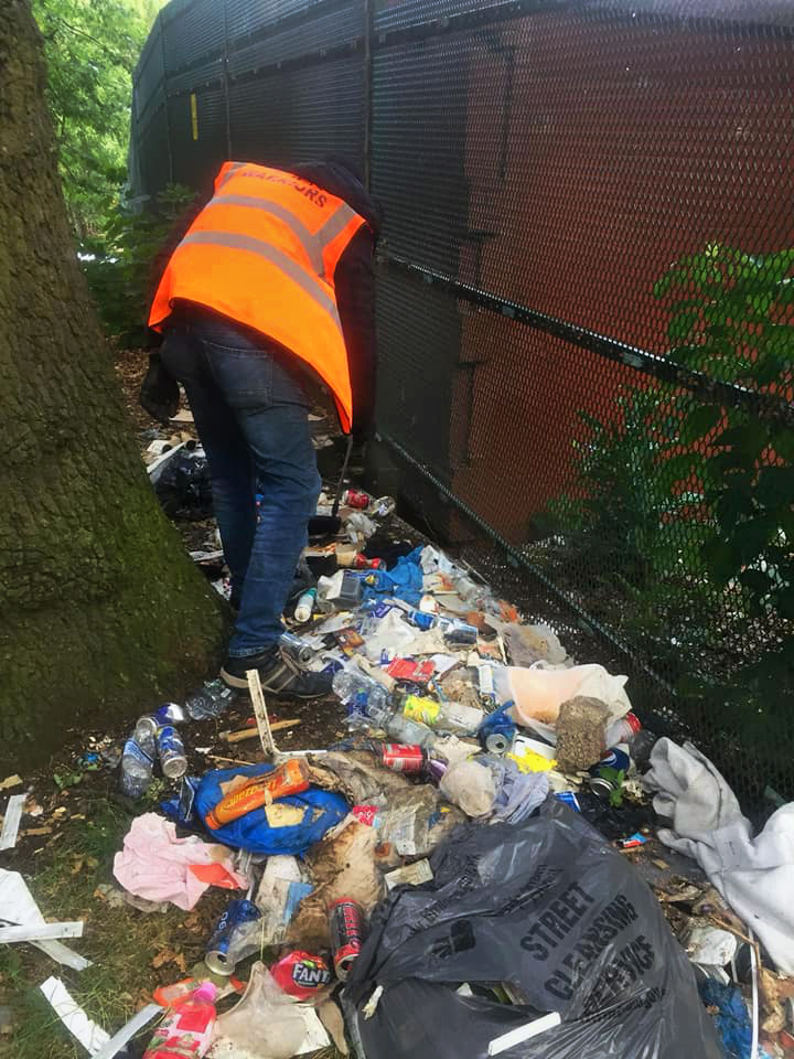 The team discovered a mound of dumped trash near the Tennyson Road side of the park