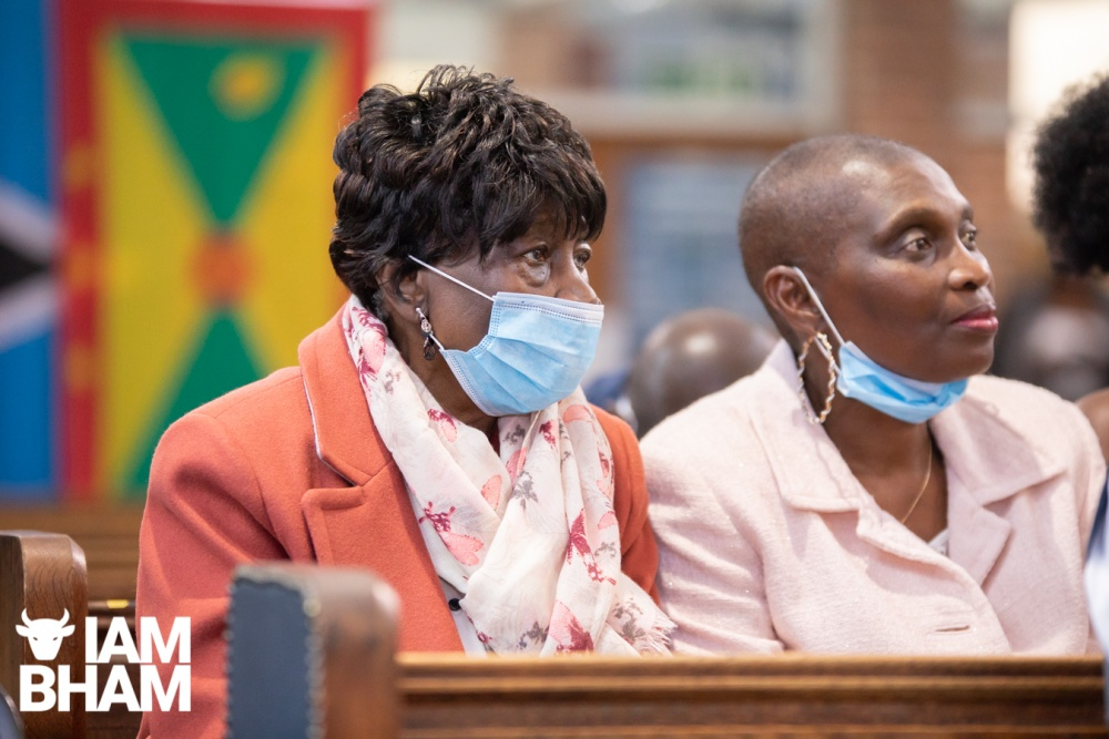 Wedding guests wearing face masks at the New Testament Church Of God in Highgate, Birmingham