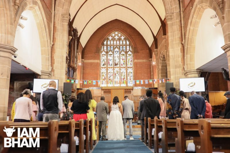Dionne Brown and Maciah Smith exchange wedding vows at the New Testament Church Of God in Highgate, Birmingham, wedding photography, lensi photography
