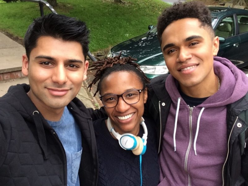 Actors Josh Williams (right) and Antonio Aakeel (left) with director Makalla McPherson, who directs the 'Life Unexpected' episode of BBC Doctors