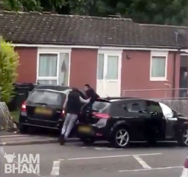 "Two men rushed out of their car to ""stab"" another driver with a stick, causing injuries"