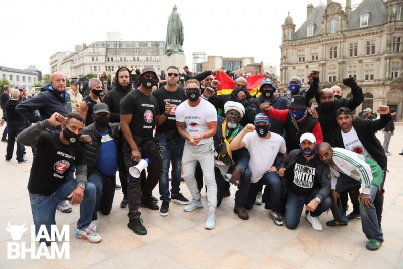 "Birmingham City fans pose in ""Straight Outta Handsworth"" and ""United Colours of Birmingham"" shirts at anti-racist march"