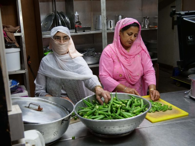 Gurmit Kaur preparing food at her local temple in Smethwick