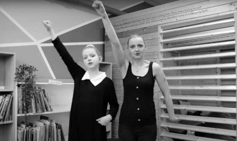 School students performing Joe Cook's poem Lock Pickin' on British Sign Language (BSL)