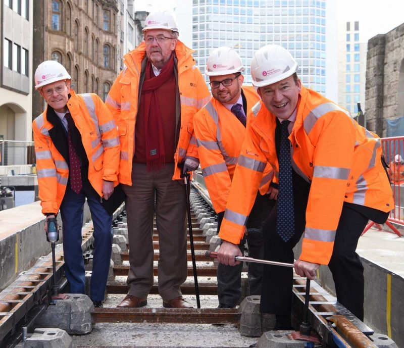 (L-R): West Midlands Mayor Andy Street helping lay the Metro track in Victoria Square with Cllr Roger Lawrence, Cllr Waseem Zaffar and Minister Jesse Norman MP