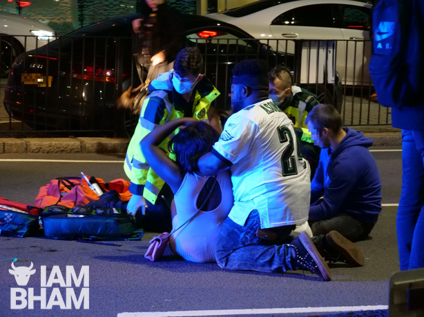 Paramedics assisting a female victim before she was taken to hospital