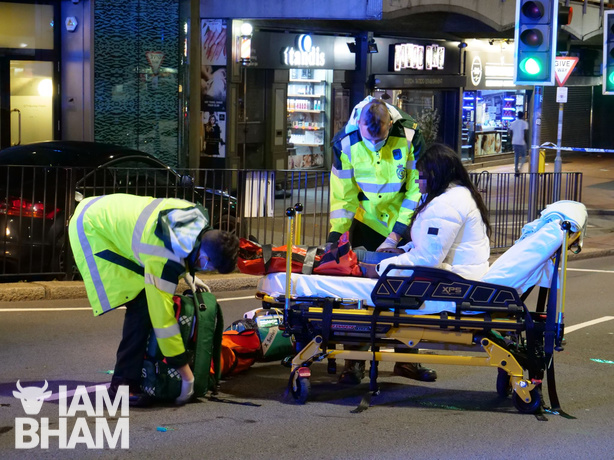 A woman is placed on a stretcher by paramedics in Holloway Circus