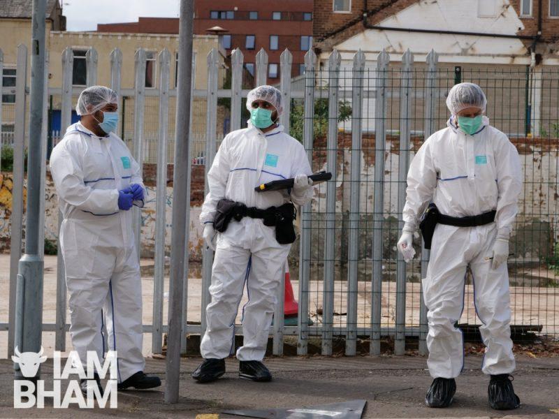 Police forensics scientists gather in Hurst Street, Birmingham