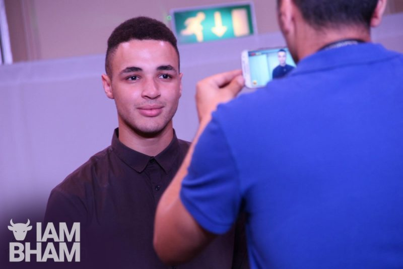 Joshua Williams being interviewed at the Elite Fashion Show he founded to raise funds for charity