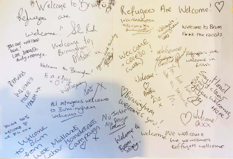 A banner signed by local residents welcoming refugees was displayed at the solidarity protest