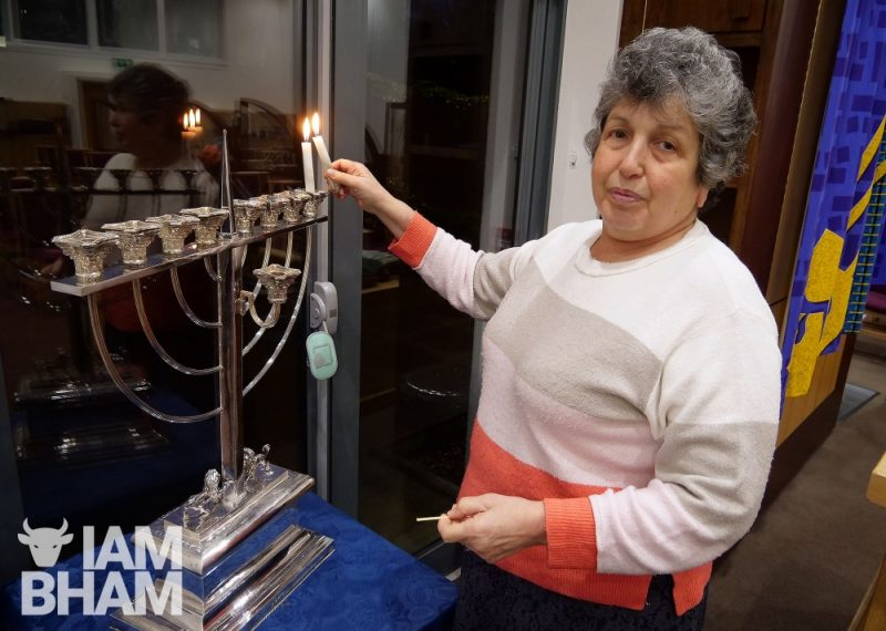 Ruth Jacobs lights a menorah candle in Birmingham on the first night of Hanukkah
