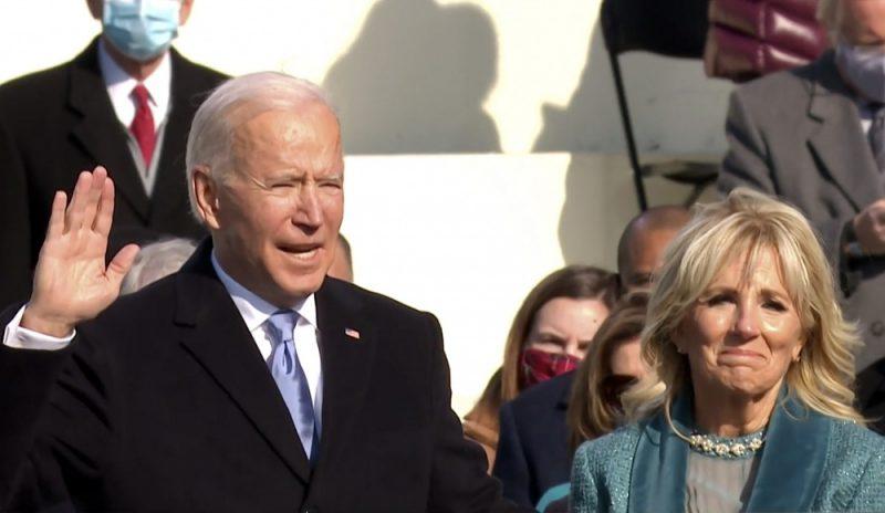 Joe BIden takes the presidential oath alongside his wife Jill Biden