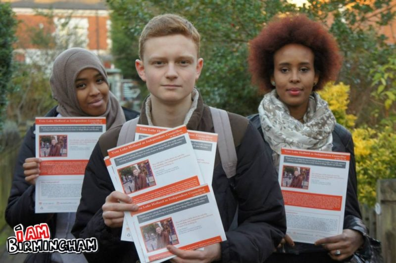 Luke Holland has roped in friends to help him distribute election flyers in the Kings Heath and Moseley ward in Birmingham