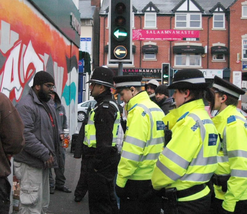 Mohammed 'Aerosol Arabic' Ali is confronted by police while painting a 'Free Gaza' Palestine mural in Small Heath in 2009