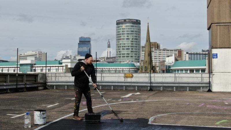 Joshua Billingham - aka Gent 48 - painting the art on a rooftop in Digbeth