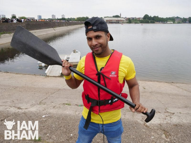 boat racer posing with oar