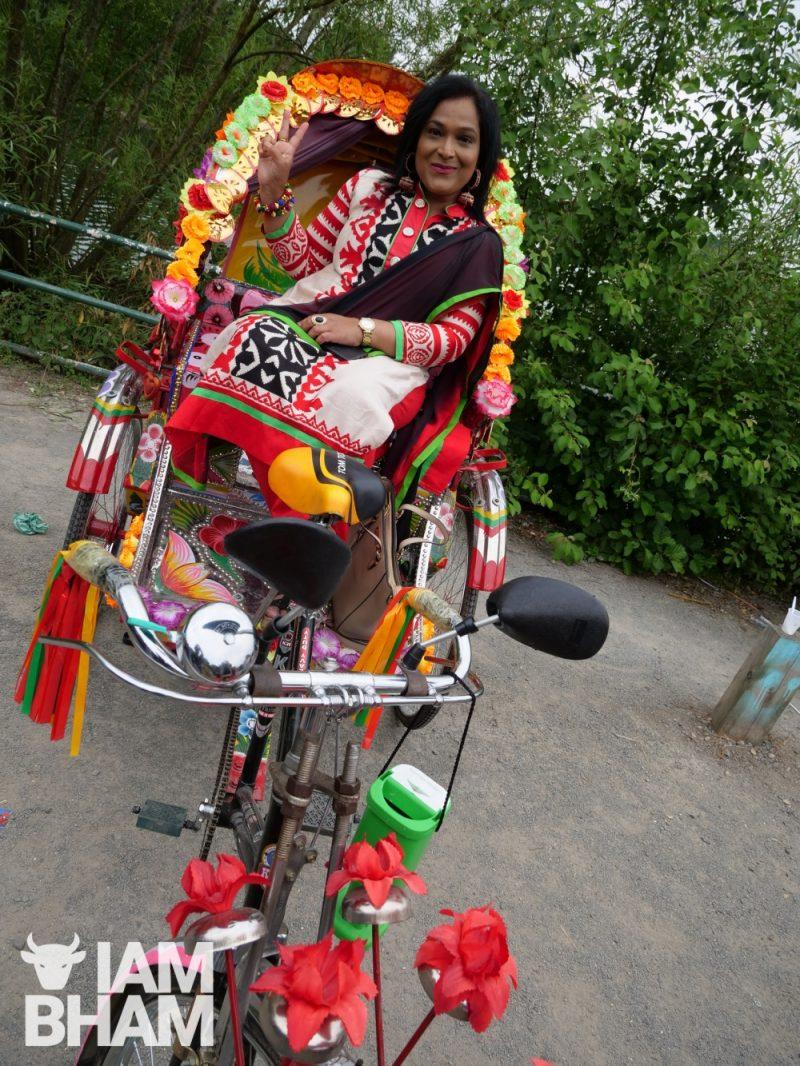 Amina Begum on a traditional Bangladeshi bike