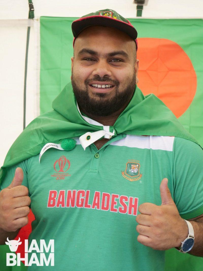 Man with Bangladesh flags