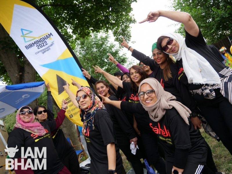 Saheli Hub women's boat racing team with Birmingham 2022 Commonwealth Games banner