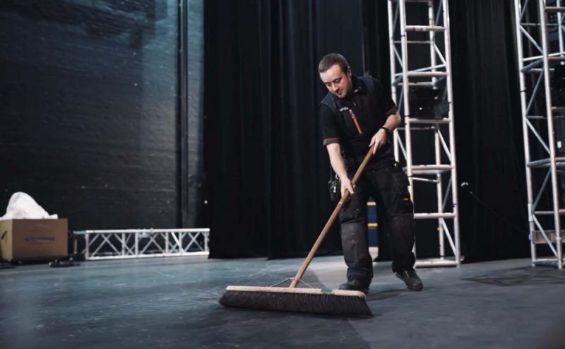 A man sweeps the stage in preparation of The Alexandra theatre's grand reopening