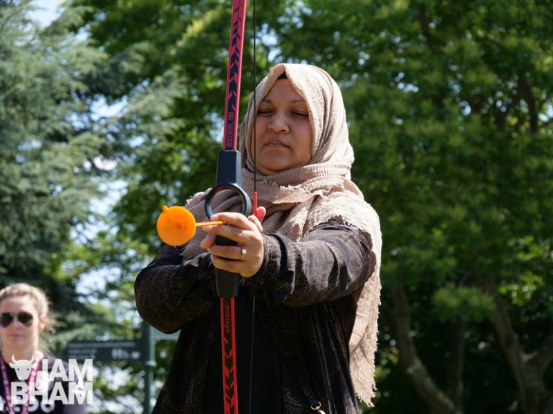 Local resident Lutfa Begum trying her hand at soft archery