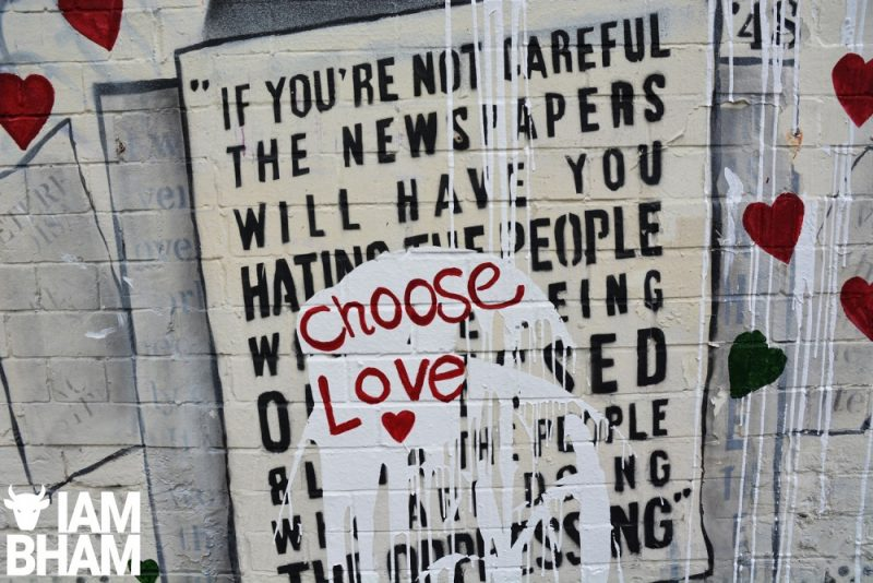 The vandalised mural was salvaged by an uplifting slogan of 'Choose Love'