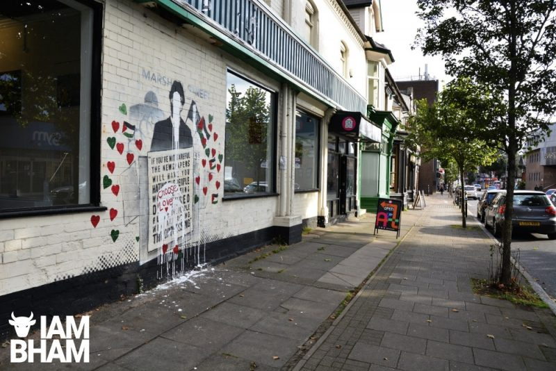 The front wall of Art Room Kings Heath displaying the defaced mural in the High Street